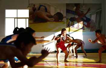 Pic story: principal of school trains hundreds of wrestlers