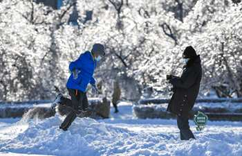 People enjoy time on Cultural Plaza after cold wave in Jilin