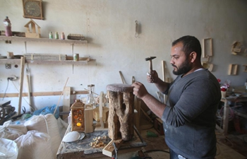 Carpenter works at carpentry in southern Gaza Strip city of Rafah