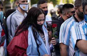 Feature: Tears and applause as fans bid farewell to Maradona