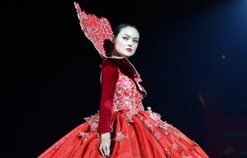 Models present creations designed by Ma Yanli