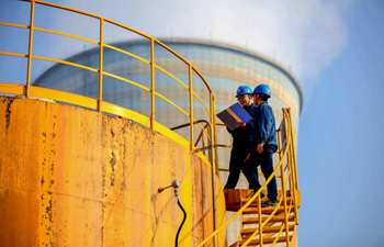 Staff members carry out inspection on production facilities in Zhejiang
