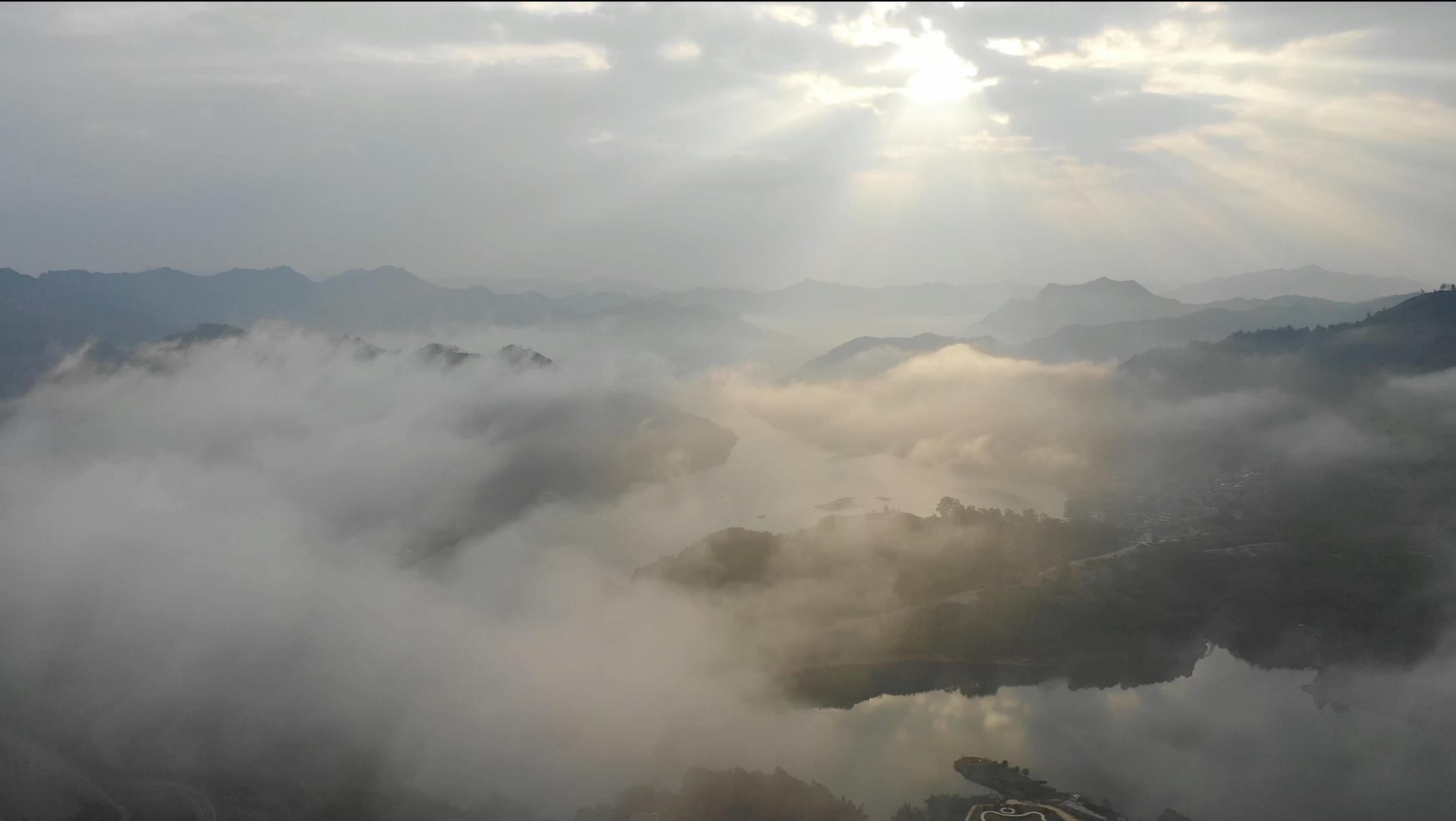 Enjoy views of sun over mountain mist