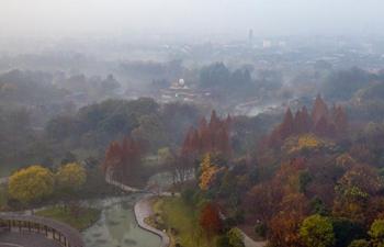 Slender West Lake amid fog in Yangzhou, E China
