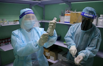 Palestinian nurses deal with COVID-19 swab samples in central Gaza Strip
