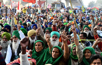 People take part in sit-in to protest against new farm laws in India