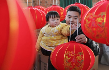 Villagers busy making lanterns for upcoming festival season