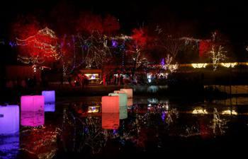 """People visit """"Winter Lights Festival"""" at Botanical Gardens during Christmas Eve celebration in Jerusalem"""