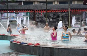 People enjoy hot spring in Jiangxi