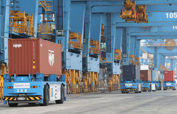 China's foreign trade defies virus odds, ends 2020 on record highs