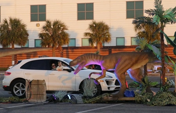 Dinosaur Adventure Drive-Thru event held in Kenner, U.S.