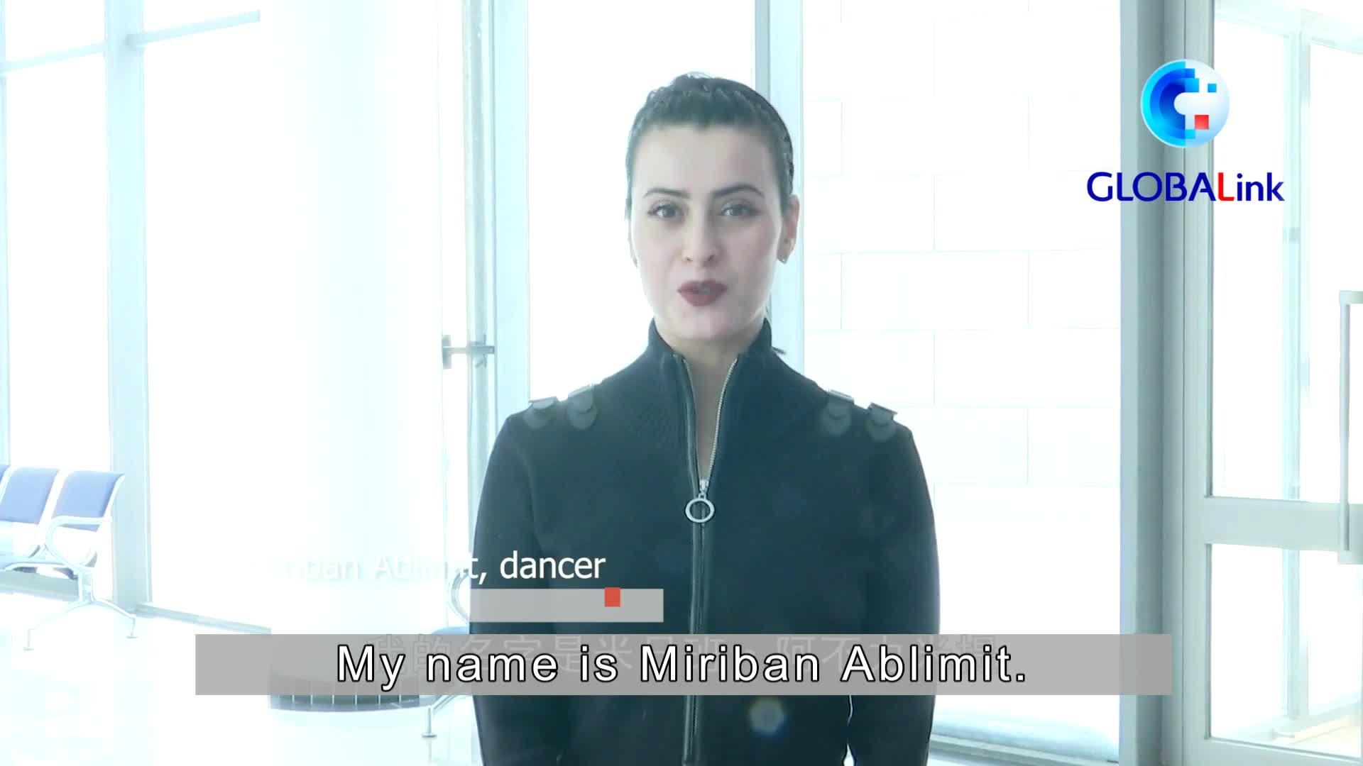 GLOBALink | #RealLifeXinjiang: Uygur dancer proud in her talent