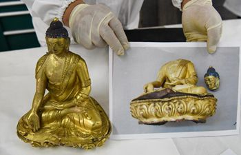 Xinjiang restores over 100 antique items