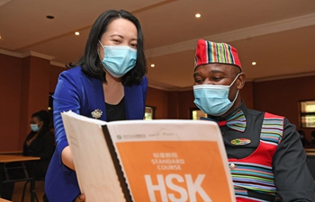 Feature: Mandarin guide graduates brace for Chinese tourists in S. Africa