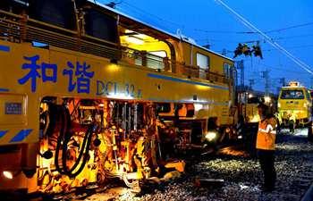 Staff members work at Huangtai Station of Qingdao-Jinan railway