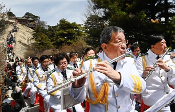 Brass symphony orchestra performs on top of Mount Huashan in Shaanxi
