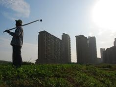 加快戶籍改革促農民融入城鎮