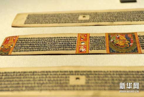 贝叶经  写在贝树叶子上的经文,是研究古代西藏文化,语言文字