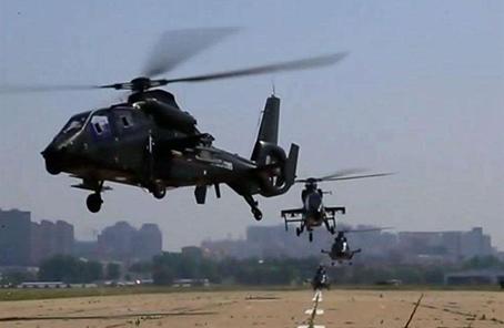 """第79集团军某旅探索""""武装直升机+无人机""""融合训练"""