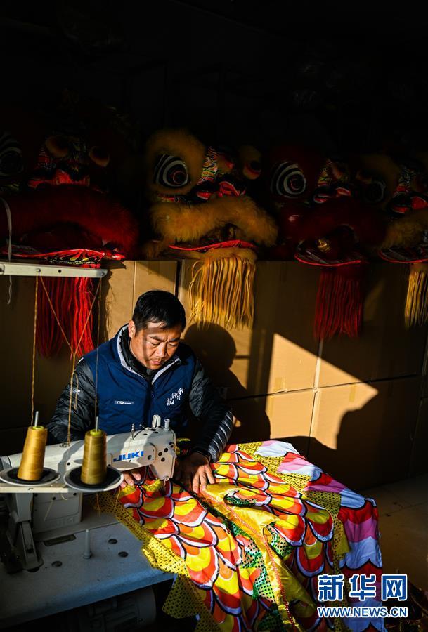 (图片故事)(8)龙狮舞者二十载的坚守与传承