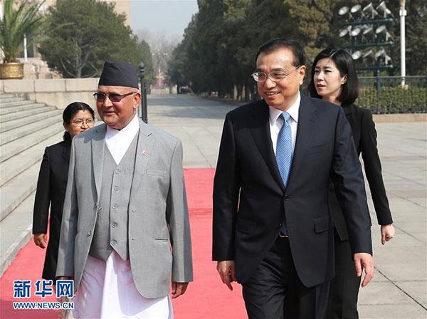 3月21日,國務院總理李克強在北京人民大會堂同來華進行正式訪問並將出席博鰲亞洲論壇2016年年會的尼泊爾總理奧利舉行會談。 新華社記者龐興雷 攝