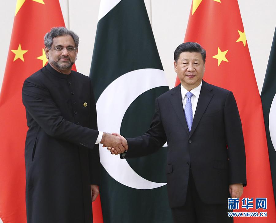 习近平会见巴基斯坦总理阿巴西农远资源网
