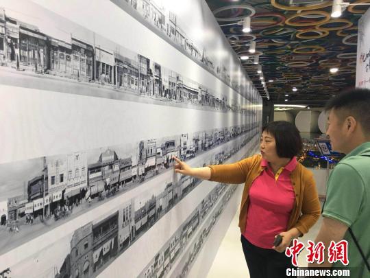 上千幅今昔对比老照片展出 见证北京四十年巨变
