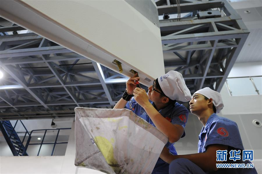 """(壮丽70年·奋斗新时代·图文互动)(3)这里是中国航天的""""技术高地""""——揭开长征火箭跨越成长的基因密码"""