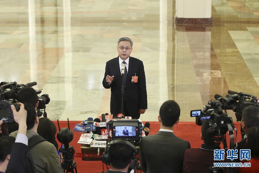 郭树清:解决民营企业融资问题需调整金融机构体系