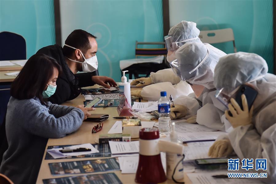 (聚焦疫情防控)(1)北京新国展入境人员转运集散地见闻
