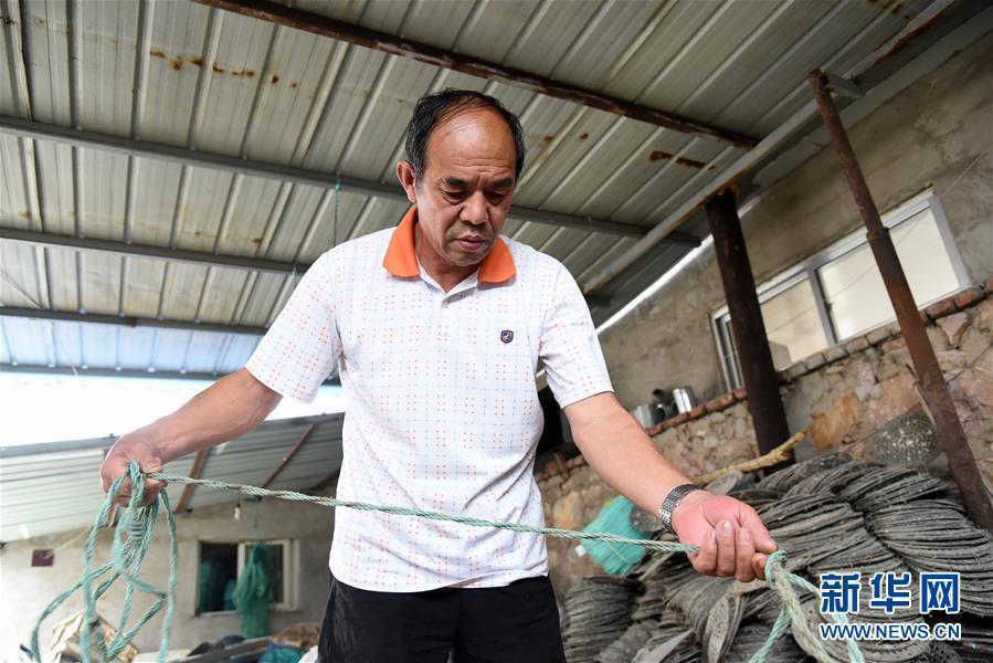 (走向我們的小康生活·圖文互動)(4)長島漁民的扇貝喜事:從請客求人買到供不應求