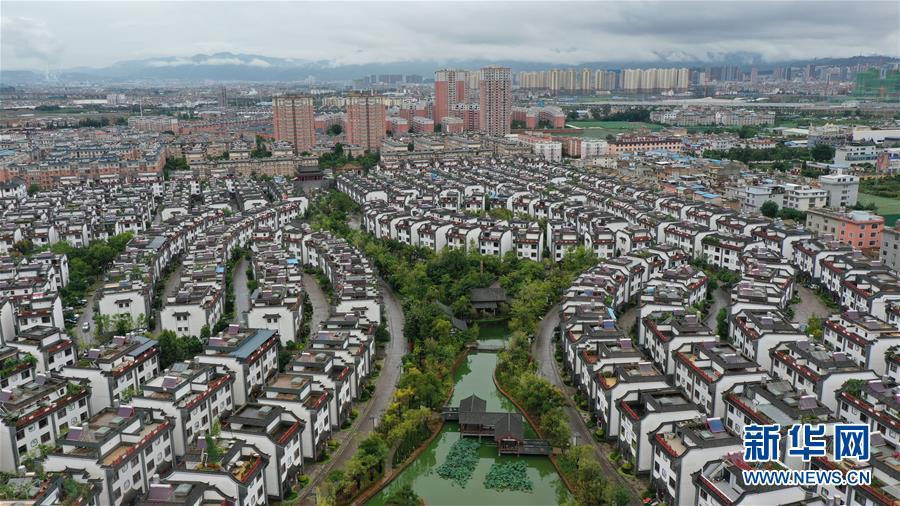 """(走向我們的小康生活·圖文互動)(2)""""雲南第一村"""",共同富裕為什麼能?"""