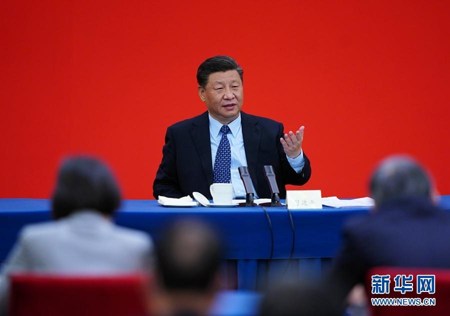 习近平看望参加政协会议的经济界委员