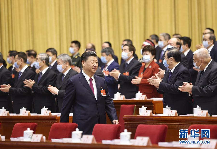 第十三届全国人民代表大会第四次会议在北京人民大会堂开幕,习近平步入会场。