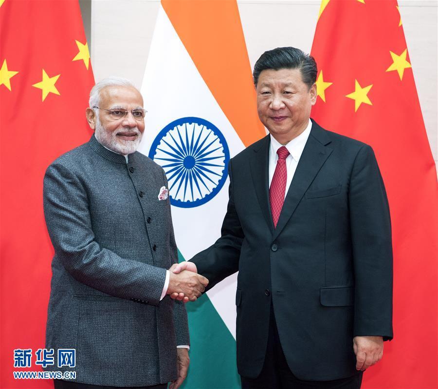 (上合青岛峰会)习近平会见印度总理莫迪