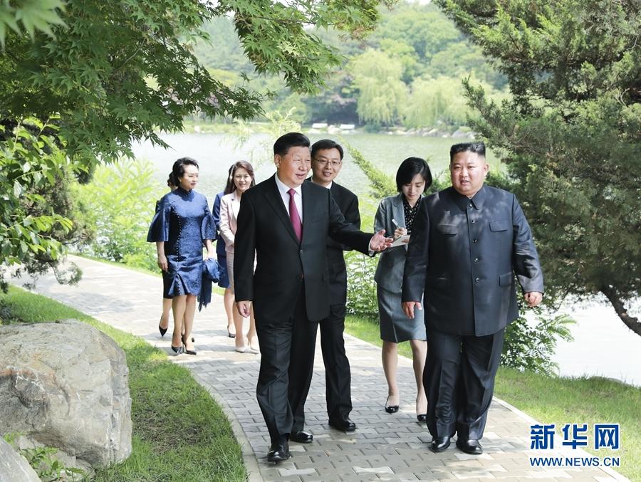 习近平会见朝鲜劳动党委员长、国务委员会委员长金正恩
