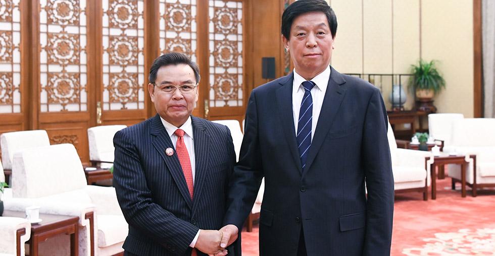 Chinese top legislator calls for closer ties with Laos