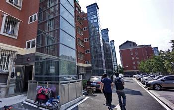 北京:老樓房裝上了新電梯