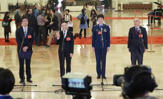 王辰、楊潔、劉文力、王旭東代表接受採訪