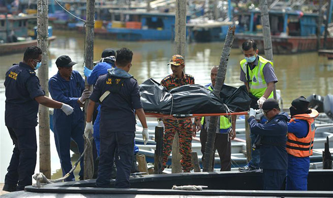 Rescuers recover one body from inside capsized dredger off Malaysia