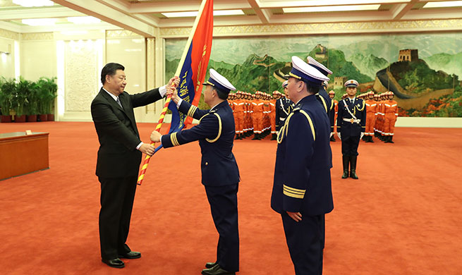 Xi confers flag to new national fire and rescue team