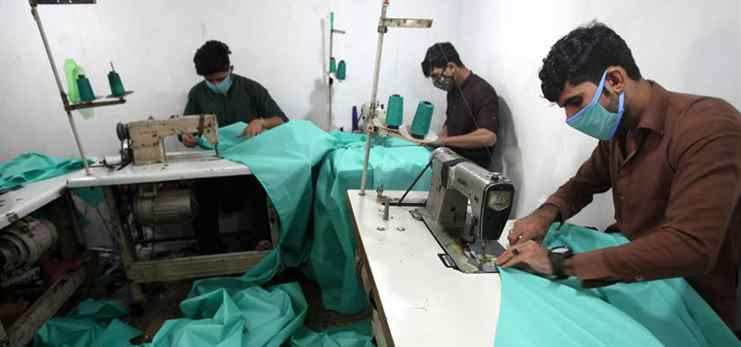 Workers make protective suits amid COVID-19 outbreak in Peshawar, Pakistan