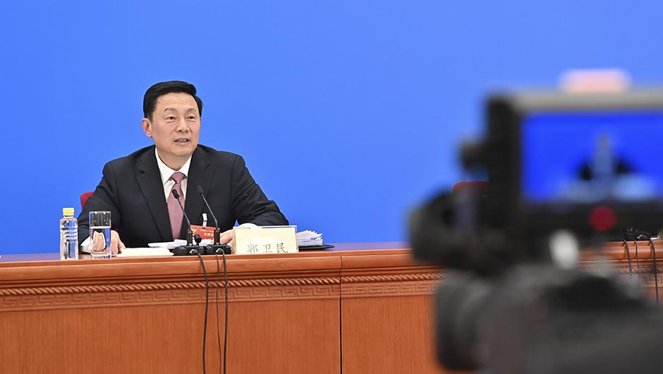 郭衛民在主會場回答記者提問