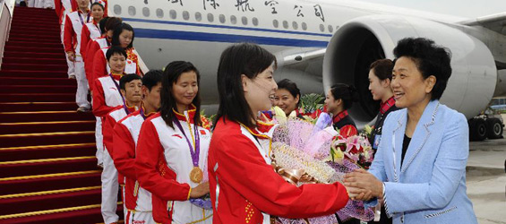 Chinese athletes return from London