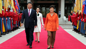 Xi attends welcome ceremony held by Park in Seoul