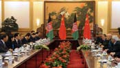 President Hu holds talks with Afghan President Karzai