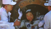 In pictures: Astronauts come out of re-entry capsule of Shenzhou-9