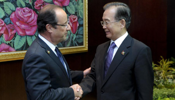 Premier Wen meets French President in Vientiane