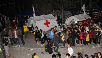 Workers & voluteers from Red Cross Society conduct relief work in quake-hit region