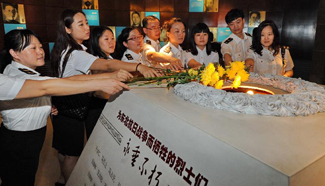 People mourn martyrs at Changchun Museum to mark start of anti-Japan war